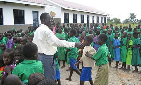 Headteacher Ben Ejadu assembles children at Amorikot primary school, Katine, at the start of the new term