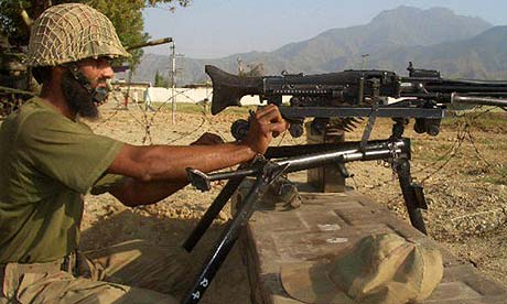 A Pakistan soldier mans a machine gun in the north-western Bajur region in Pakistan