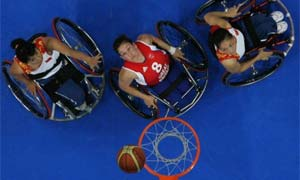 Basketball players wait for a rebound during the 2008 Paralympic Games