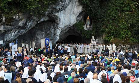 Pilgrims celebrate mass by the Basilica of the and the Grotto of Massbielle in the Sanctuary of Lourdes in September 2008
