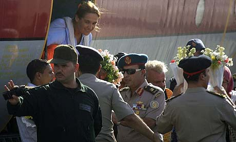 Officials in Cairo greet a plane carrying the European tourists freed after a 10-day kidnap ordeal