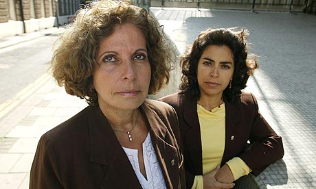 Olga Salanueva Arango (L) and Adriana Perez O'Connor, wives of two Cuban nationals arrested and jailed on charges of intent to commit espionage and threatening US national security