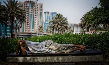 Workers sleep on the street in Dubai
