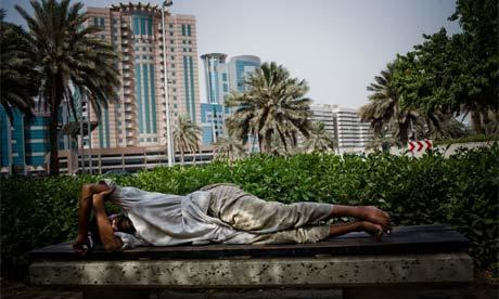 Workers sleep on the street in Dubai.