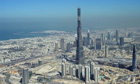 The Burj Dubai, the world's tallest building, rises above the city
