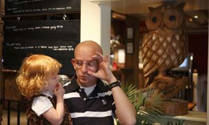 Ramon Woolfe teaches his daughter Layla, 3, how to sign the word 'owl'