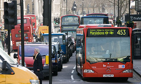 A bus stands in heavy traffic in Trafalgar Square, London