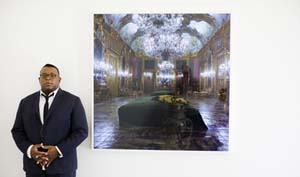 Issac Julien in front of one of his works. Photograph: Felix Clay
