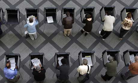 Dozens of people filled the voting booths at the Wellington Webb building in downtown Denver, as early voting began yesterday. Photograph: Javier Manzano/AP