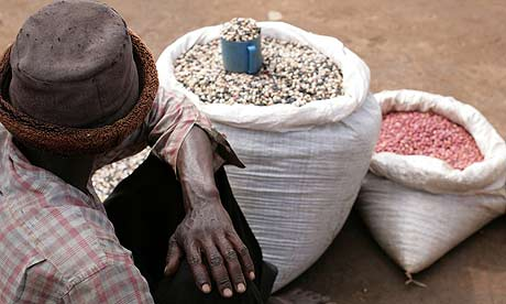 A man selling beans at Katine market