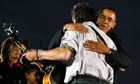 Barack Obama hugs singer Bruce Springsteen during a campaign rally