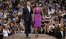Barack Obama analysis: Barack Obama and his wife Michelle Obama onstage during a rally