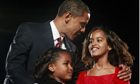 Barack Obama with his daughters Sasha and Malia. Photograph: Jason Reed/Reuters