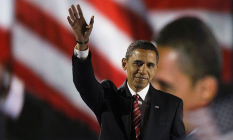 Barack Obama waves to the crowd before giving his victory speech