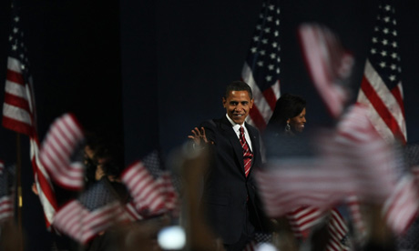Barack Obama and wife Michelle wave to supporters at their election night rally in Chicago
