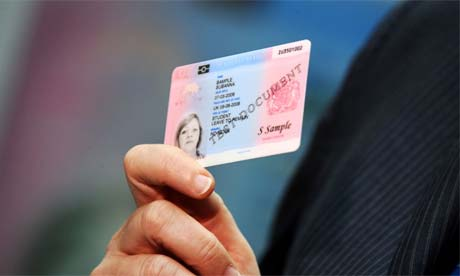 Jacqui Smith holds a sample British identity card