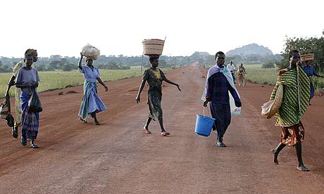 Women walking to Katine market on the new road