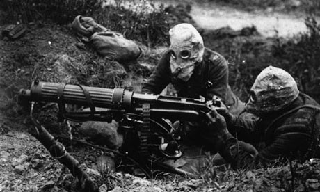 Soldiers in gas masks manning a machine gun