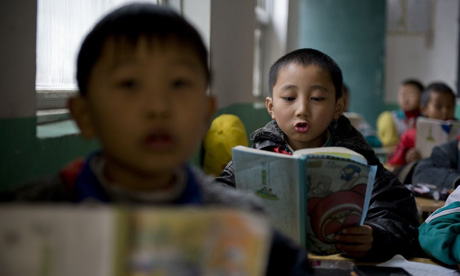 Children reading at school in Beijing, China