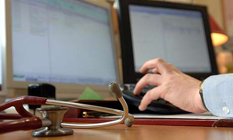 A GP in his surgery. There are fears private information could be given to researchers