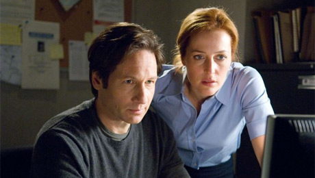 Agents Mulder and Scully at their desk, probably reading fanfiction sites.