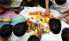 Relatives grieve over the body of Harish Gohil during a funeral possession in Mumbai