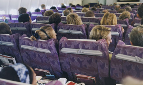 Passengers in airplane seats