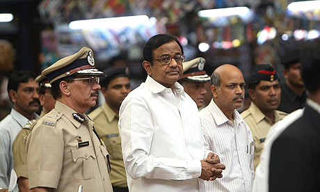 India's interior minister, Palaniappan Chidambaram (c), leaves the Chatrapathi Shivaji Terminus (CST) after meeting senior police officers and touring sites of the Mumbai terror attacks