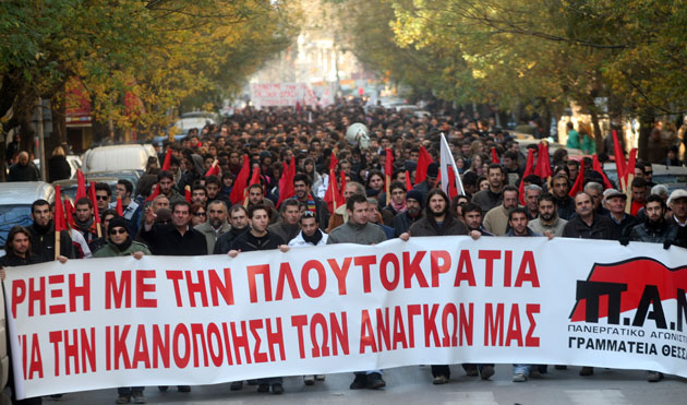 Greek workers demonstrate against plutocracy, mentioned on their banner