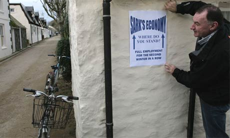 Kevin Delaney, the Barclay brothers' representative on Sark, puts up an election poster