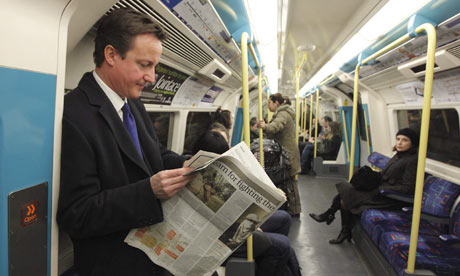 Britain's Conservative Party leader Cameron travels on the tube after a news conference in London