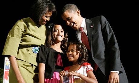 Barack and Michelle Obama with daughters Malia (2nd left) and Sasha