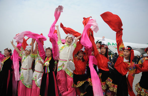 Ethic Qiang performers cheer after the farewell ceremony held for giant pandas