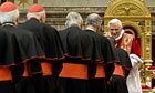 Pope Benedict XVI greets cardinals in the Clementine Hall at the Vatican