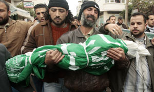 Palestinian man carries body of daughter in Gaza