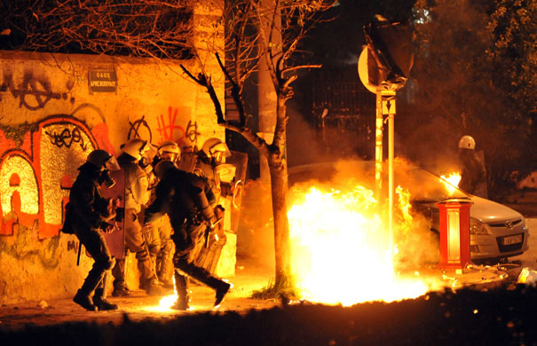 Gallery Riots in Athens: Riot police avoid fire bombs outside Aristotle University in Thessaloniki