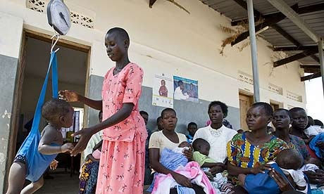 Babies and toddlers are weighed during an immunisation programme at the Ojom health centre, Katine