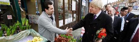 Boris Johnson shakes hands with a London shopkeeper