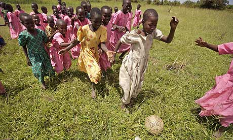 Pupils at Katine primary school playing football.