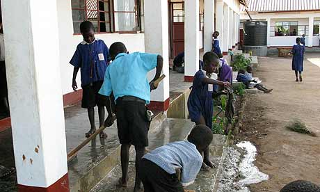 Katine: Children clean the steps of the school at Tekera village in southern Uganda