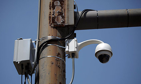 A security camera is mounted on a utility pole in Lancaster, Pennsylvania.
