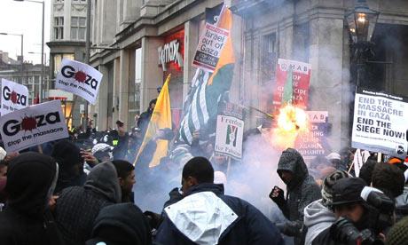 Demonstrators let off fireworks outside the Israeli embassy in London