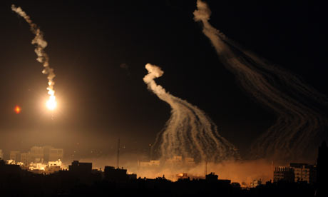 Flares and smoke are seen during an Israeli military operation in Gaza City