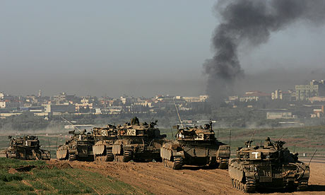 A column of Israeli tanks take up postion near the Gaza border