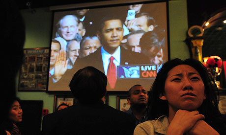 People in a Beijing bar watch the inauguration of the US president, Barack Obama