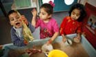 Children play with sand at Abbey Green Nursery School and Childrens' Centre in Bradford
