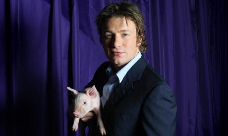 Jamie Oliver holds a pig