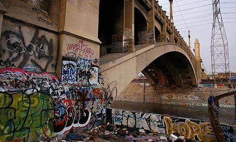 Graffiti covers a bridge that crosses the Los Angeles river