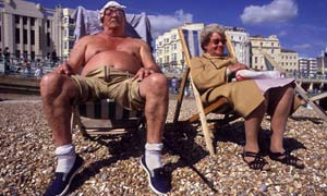 The full English: a couple on the beach at Brighton.