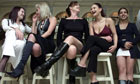 Prostitutes wait at a bar in a plush northern suburb of Johannesburg, South Africa, Aug 22, 2002